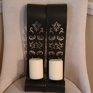Set of metal sconces with candles